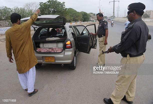 Pakistani policemen search a car in a troubled area of Karachi on August 3 2011 At least 35 people were killed in 24 hours in Karachi as Pakistan's...