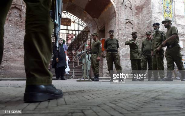Pakistani policemen stand guard during the Friday prayer at the Wazir Khan Mosque in Lahore on May 17 on the Muslim month of Ramadan