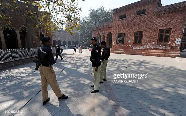 Pakistani policemen stand guard during the hearing of a CIA contractor Raymond Davis outside the High court building in Lahore on March 14 2011 A...