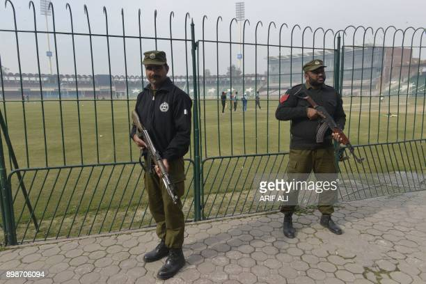 Pakistani policemen stand guard during the national cricket team's practice at the Qaddafi Stadium in Lahore on December 26 2017 Pakistan still have...