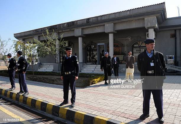 Pakistani policemen stand guard in front of the High Court building on January 24 during the judicial commission probing into a secret memo scandal....