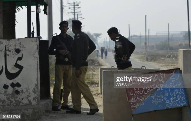 Pakistani policemen stand guard outside the check pint of Kot Lakhpat Jail where Mohammad Imran the suspect accused of raping and murdering a young...
