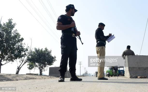 Pakistani policemen stand guard outside the checkpoint of Kot Lakhpat jail where Imran Ali the suspect accused of raping and murdering sixyearold...