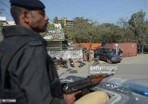 Pakistani policemen stand guard outside the French consulate following protests there against the printing of satirical sketches of the Prophet...