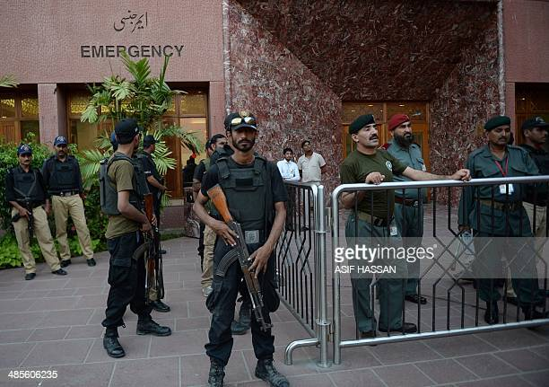Pakistani policemen stand guard outside the hospital where prominent Pakistani journalist Hamid Mir is being treated after an attack in Karachi on...