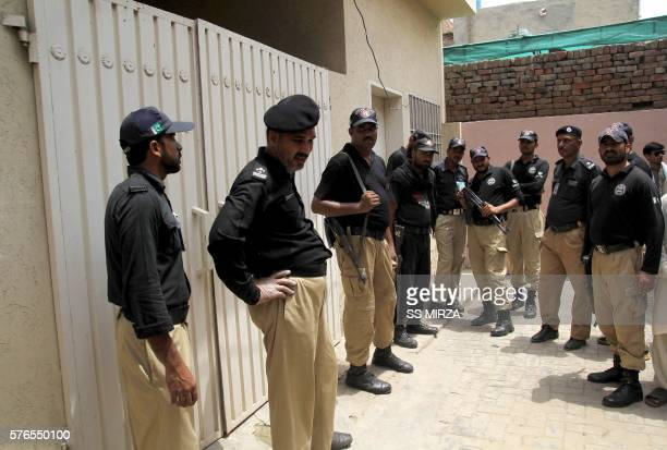Pakistani policemen stand guard outside the house of social media celebrity Qandeel Baloch who was murdered by her brother in Multan on July 16 2016...