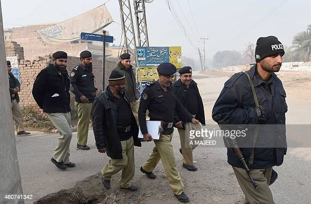 Pakistani policemen take part in a search operation around the army run school which was attacked by Taliban militants in Peshawar on December 21...