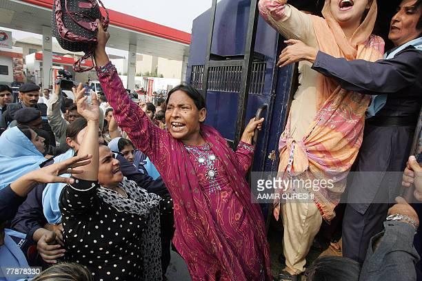 Pakistani policewomen arrest supporters of former Pakistani prime minister Benazir Bhutto as they shout antiMusharraf slogans near the Bhutto...