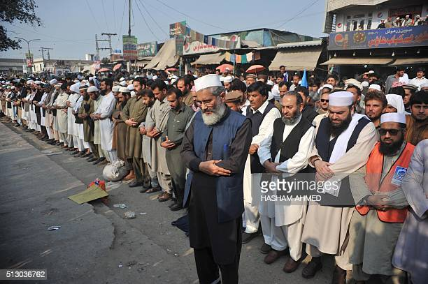 Pakistani political and Islamic party JammateIslami chief SirajulHaq offers funeral prayers for convicted murderer Mumtaz Qadri following his...