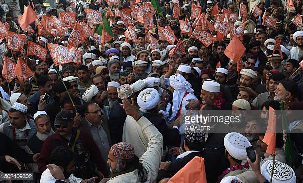 Pakistani political and religious party members take part in a march to mark the birthday of the Prophet Mohammed in Peshawar on December 24 2015 The...