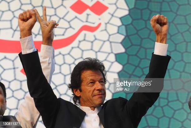Pakistani politician and former cricketer Imran Khan gestures upon his arrival during a rally in Lahore on October 30, 2011. A crowd of thousands...
