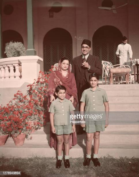 Pakistani politician Liaquat Ali Khan , Prime Minister of Pakistan, stands with his wife Ra'ana Liaquat Ali Khan and two sons at a residence in...