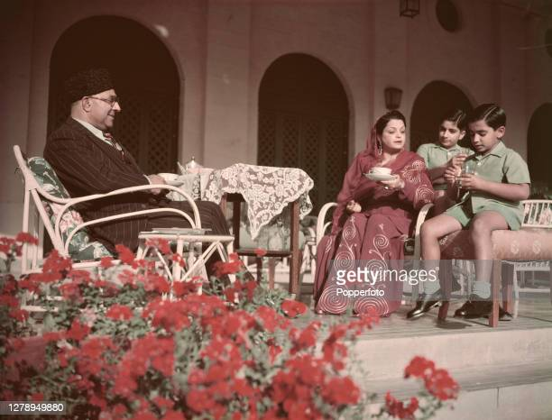 Pakistani politician Liaquat Ali Khan , Prime Minister of Pakistan, sits with his wife Ra'ana Liaquat Ali Khan and two sons at a residence in...