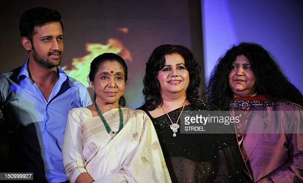 Pakistani pop singer Atif Aslam Indian playback singer Asha Bhosle Bangladeshi Singer Runa Laila and Pakistani Sufi Singer Abida Parveen pose during...