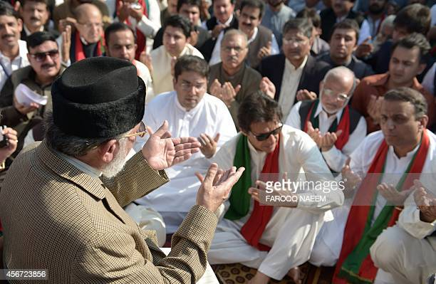 Pakistani populist cleric TahirulQadri and opposition leader Imran Khan offer Eid alAdha prayers during ongoing antigovernment protests outside the...