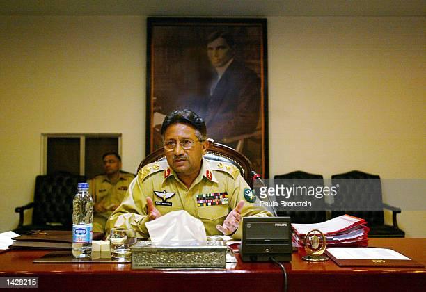 Pakistani President General Pervez Musharraf opens the weekly Cabinet meeting July 3, 2002 in Rawalpindi, Islamabad Pakistan.