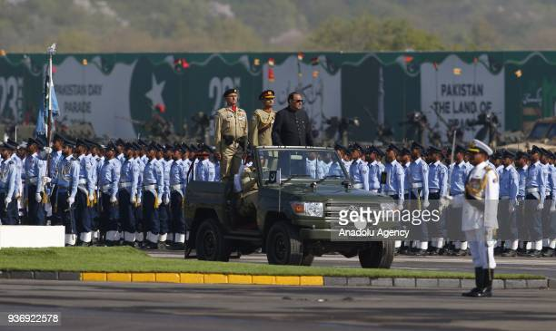 Pakistani President Mamnoon Hussain inspects the honour guards prior to a military parade to mark Pakistan's National Day in Islamabad Pakistan on...