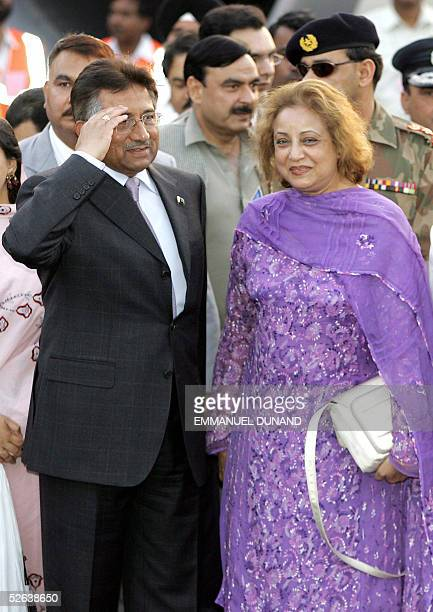 Pakistani President Pervez Musharraf accompanied by his wife Begum Sehba salutes upon his arrival in New Delhi 16 April 2005 Indian Prime Minister...