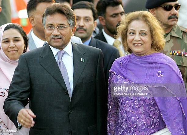 Pakistani President Pervez Musharraf accompanied by his wife Begum Sehba smiles upon his arrival in New Delhi 16 April 2005 Indian Prime Minister...
