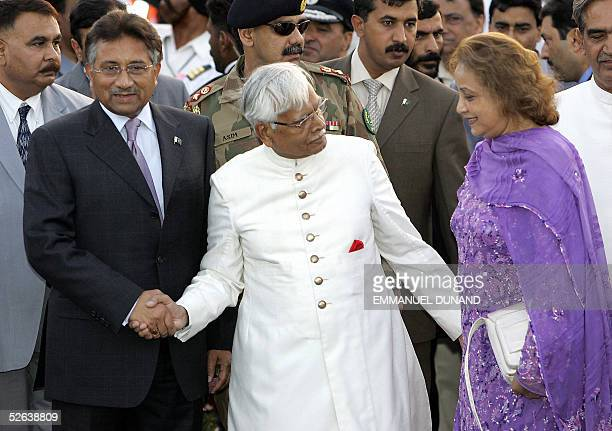 Pakistani President Pervez Musharraf and his wife Begum Sehba are welcomed by Indian Foreign Minister Natwar Singh upon their arrival in New Delhi 16...