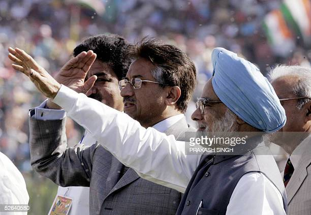 Pakistani President Pervez Musharraf and Indian Prime Minister Manmohan Singh salute the crowd while arriving on the pitch for the final one day...