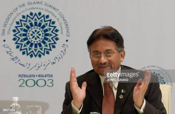 Pakistani President Pervez Musharraf gestures while answering a question during a press conference on the sidelines of the Organisation of the...