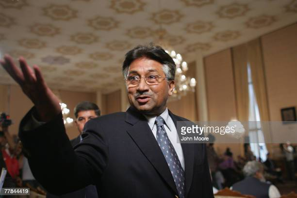 Pakistani President Pervez Musharraf greets a journalist while arriving for a press conference November 11, 2007 at the President House in Islamabad,...