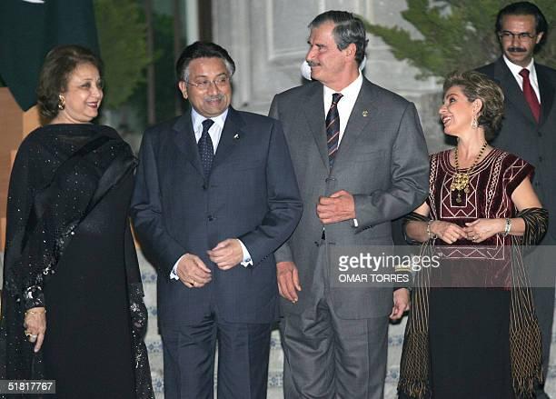 Pakistani President Pervez Musharraf his wife Sehba Musharraf Mexican President Vicente Fox and his wife Marta Sahagun pose during a welcoming...