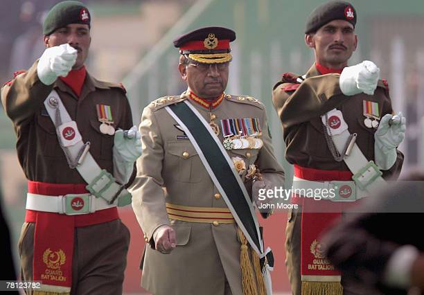 Pakistani President Pervez Musharraf is escorted by a military honor guard at a change of command ceremony on November 28 2007 in Rawalpindi Pakistan...