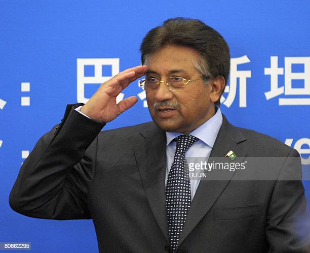 Pakistani President Pervez Musharraf salutes to Chinese students as he leaves after his speech at the Tsinghua University in Beijing on April 14 2008...