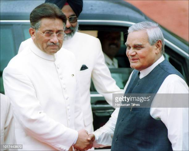 Pakistani President Pervez Musharraf shakes hand with Indian Prime Minister Atal Bihari Vajpayee during an official welcome ceremony at the...