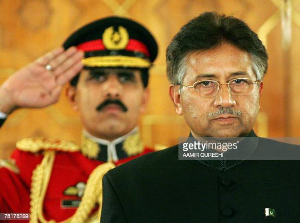 Pakistani President Pervez Musharraf stands after taking the oath as a civilian president at the presidential palace in Islamabad, 29 November 2007....