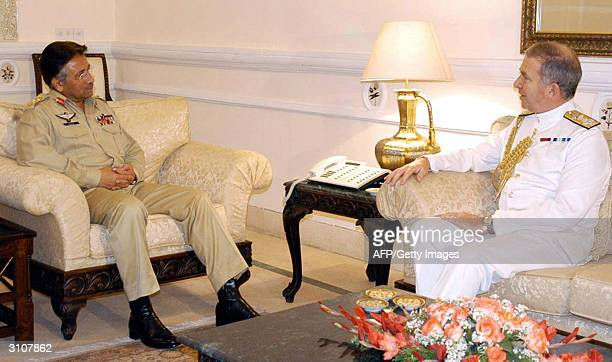 Pakistani President Pervez Musharraf talks with Admiral Sir Alan West First Sea Lord and Chief of Britain's Naval Staff during a meeting in...