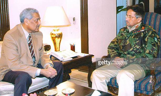 Pakistani President Pervez Musharraf talks with the founder of Pakistan's nuclear programme Abdul Qadeer Khan in Rawalpindi 04 February 2004 Khan...