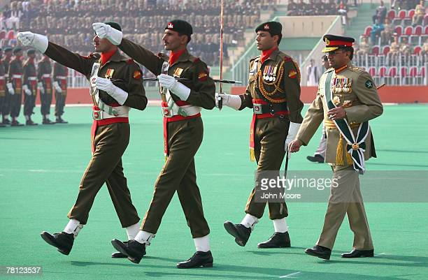 Pakistani President Pervez Musharraf walks to review a military honor guard at a change of command ceremony on November 28 2007 in Rawalpindi...