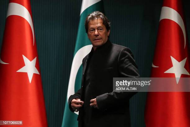 Pakistani Prime Minister Imran Khan arrives for a joint press conference with the Turkish President at the Presidential Complex in Ankara on January...