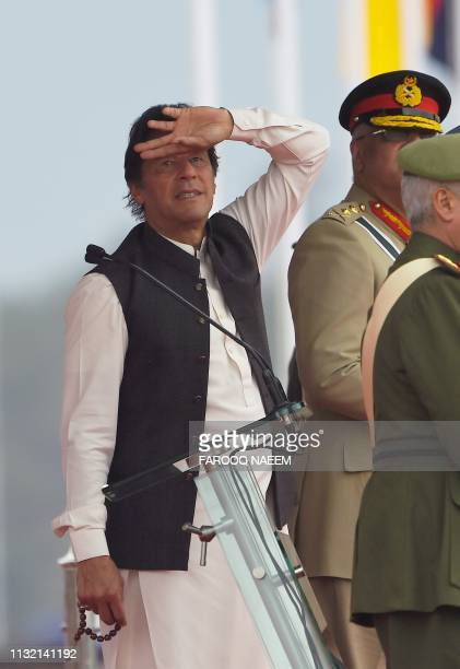 Pakistani Prime Minister Imran Khan look at the fighter jet performance during the Pakistan Day parade in Islamabad on March 23 2019 Pakistan...