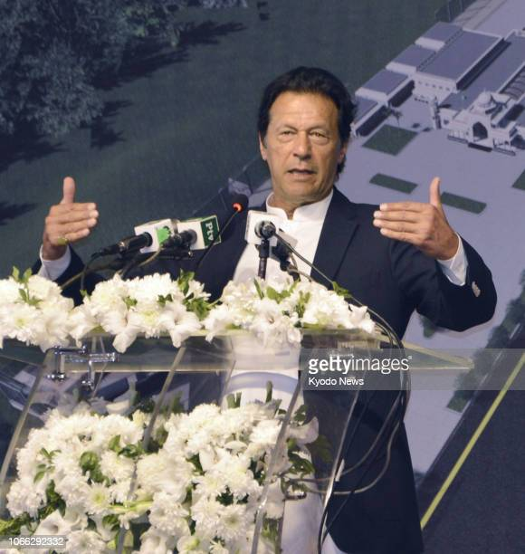 Pakistani Prime Minister Imran Khan speaks at a groundbreaking ceremony in Narowal central Pakistan for the Kartarpur corridor between Pakistan and...