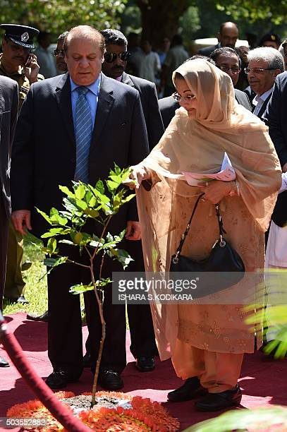 Pakistani Prime Minister Nawaz Sharif and his wife Kalsoom Nawaz Sharif plant a tree during a visit to The Peradeniya Royal Botanical Garden in Kandy...