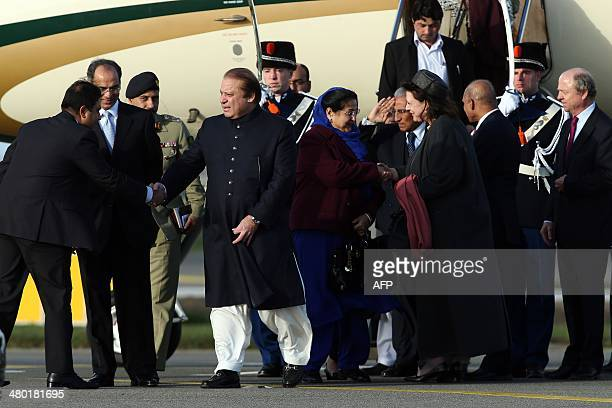 Pakistani Prime Minister Nawaz Sharif shakes hands with an unidentified official as he arrives at Schiphol airport in Amsterdam on March 23, 2014...