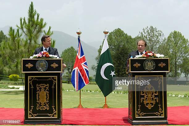 Pakistani Prime Minister Nawaz Sharif speaks beside British Prime Minister David Cameron during a press conference at the Prime Minister's house on...