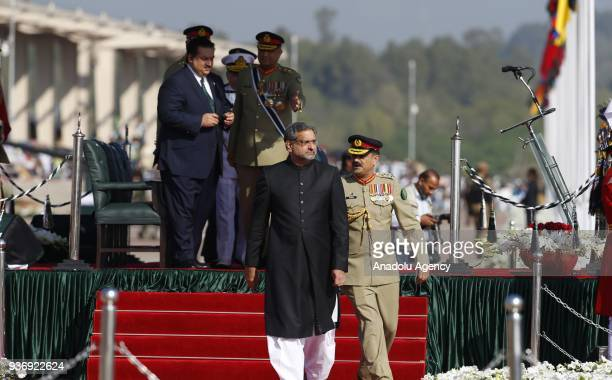 Pakistani Prime Minister Shahid Khaqan Abbasi attends a military parade marking the Pakistan's National Day in Islamabad Pakistan on March 23 2018