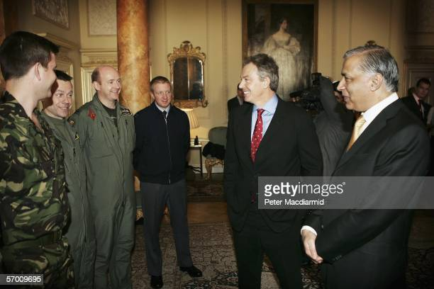 Pakistani Prime Minister Shaukat Aziz and Prime Minister Tony Blair meet with members of the military and emergency workers that helped survivors of...