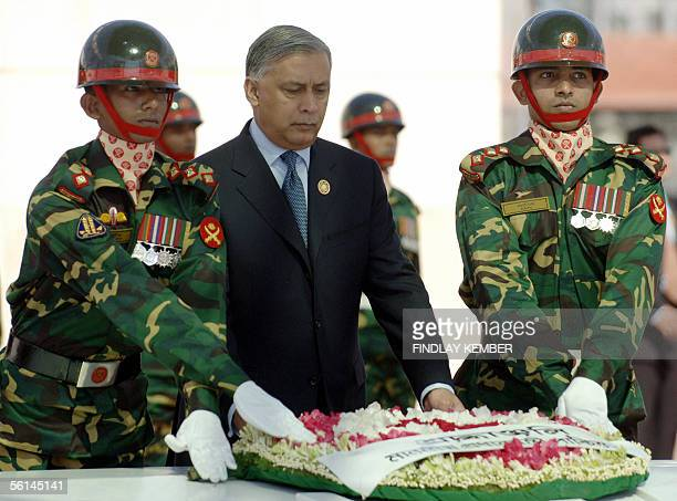 Pakistani Prime Minister Shaukat Aziz is assisted by Bangladeshi soldiers as he lays a wreath at The Mazar of Shaheed President Ziaur Rahman memorial...
