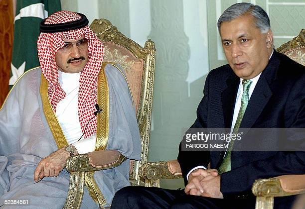 Pakistani Prime Minister Shaukat Aziz looks on as Saudi Prince Al Waleed bin Talal al Saud answers a question during a press briefing in Islamabad 14...