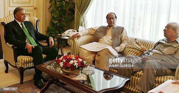 Pakistani Prime Minister Shaukat Aziz speaks with the chief of the ruling party of Pakistan Muslim LeagueQuaid Chaudhry Shujaat and the speaker of...