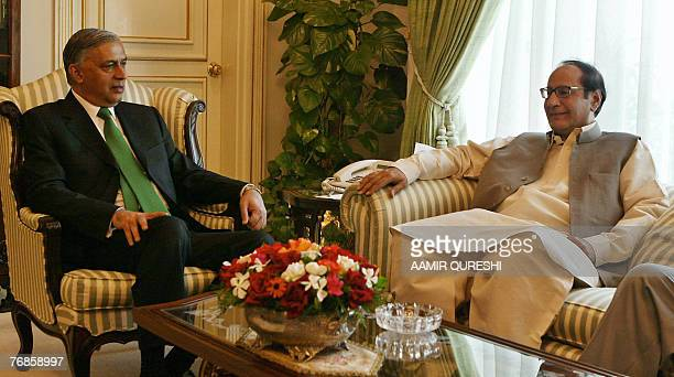 Pakistani Prime Minister Shaukat Aziz speaks with the chief of the ruling party of Pakistan the Muslim LeagueQuaid Chaudhry Shujaat during a meeting...
