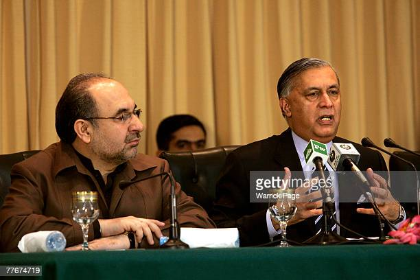 Pakistani Prime Minister Shaukat Aziz talks to local and international media at a press conference with Federal Minister for Information Mohammed Ali...