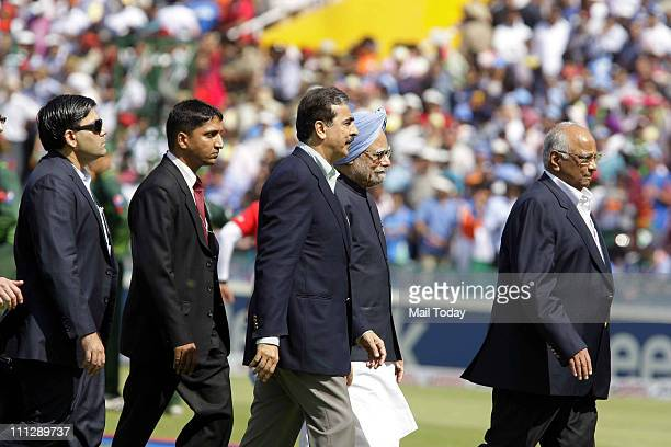 Pakistani Prime Minister Yousuf Raza Gilani and Indian Prime Minister Manmohan Singh with Sharad Pawar walk back to the pavilion after meeting with...