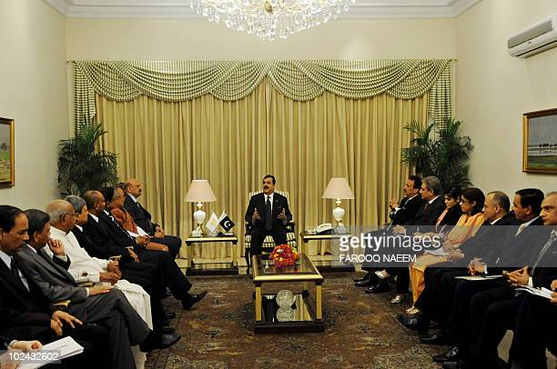 Pakistani Prime Minister Yousuf Raza Gilani talks with ministers from the South Asian Association for Regional Cooperation in Islamabad on June 26...